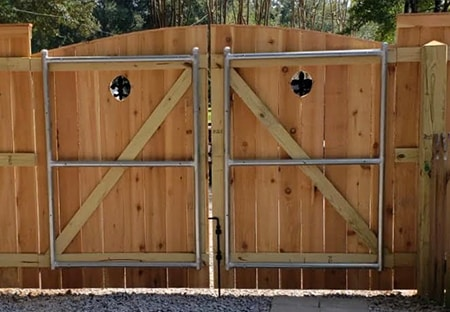 Re-enforced Double Wooden Gate with Portholes | Mandeville Fence Company
