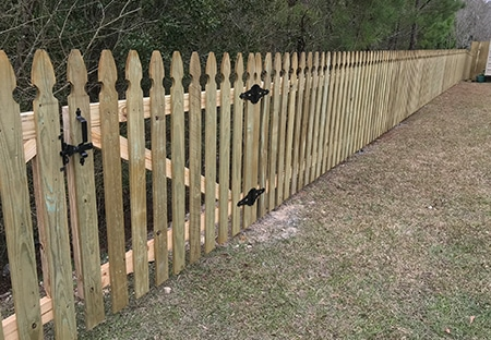 Pressure-Treated Wood Picket Fence in Lacombe